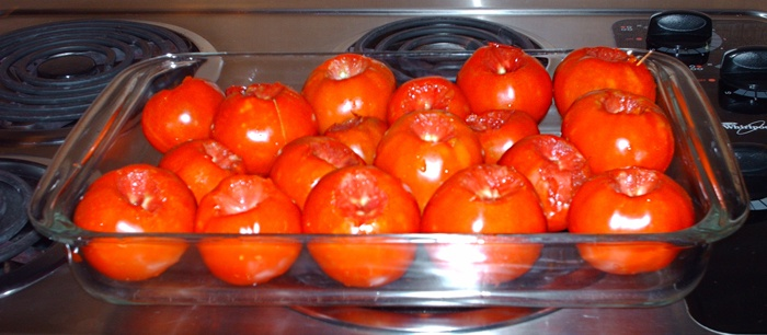 Tomatoes in Pyrex baking dish prior to roasting.