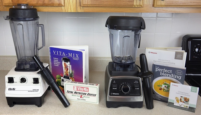 Vitamix 5000 and 750 Professional side by side with accessories included in box.