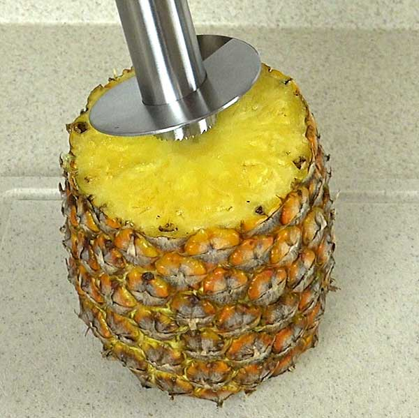 Lining up bottom of corer with the pineapple core
