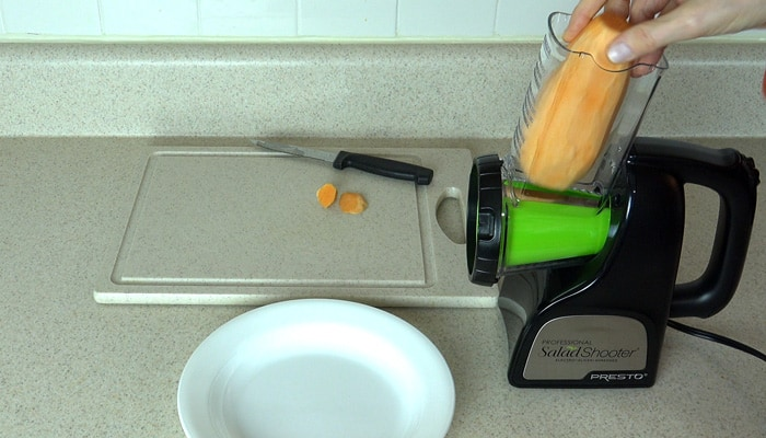 The Food Chute of the Professional Salad Shooter holds a Peeled Sweet Potato ready to be sliced