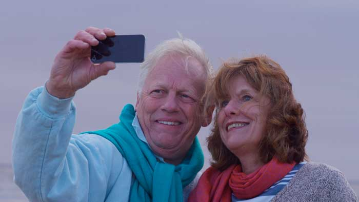 Older couple taking a selfie with cell phone